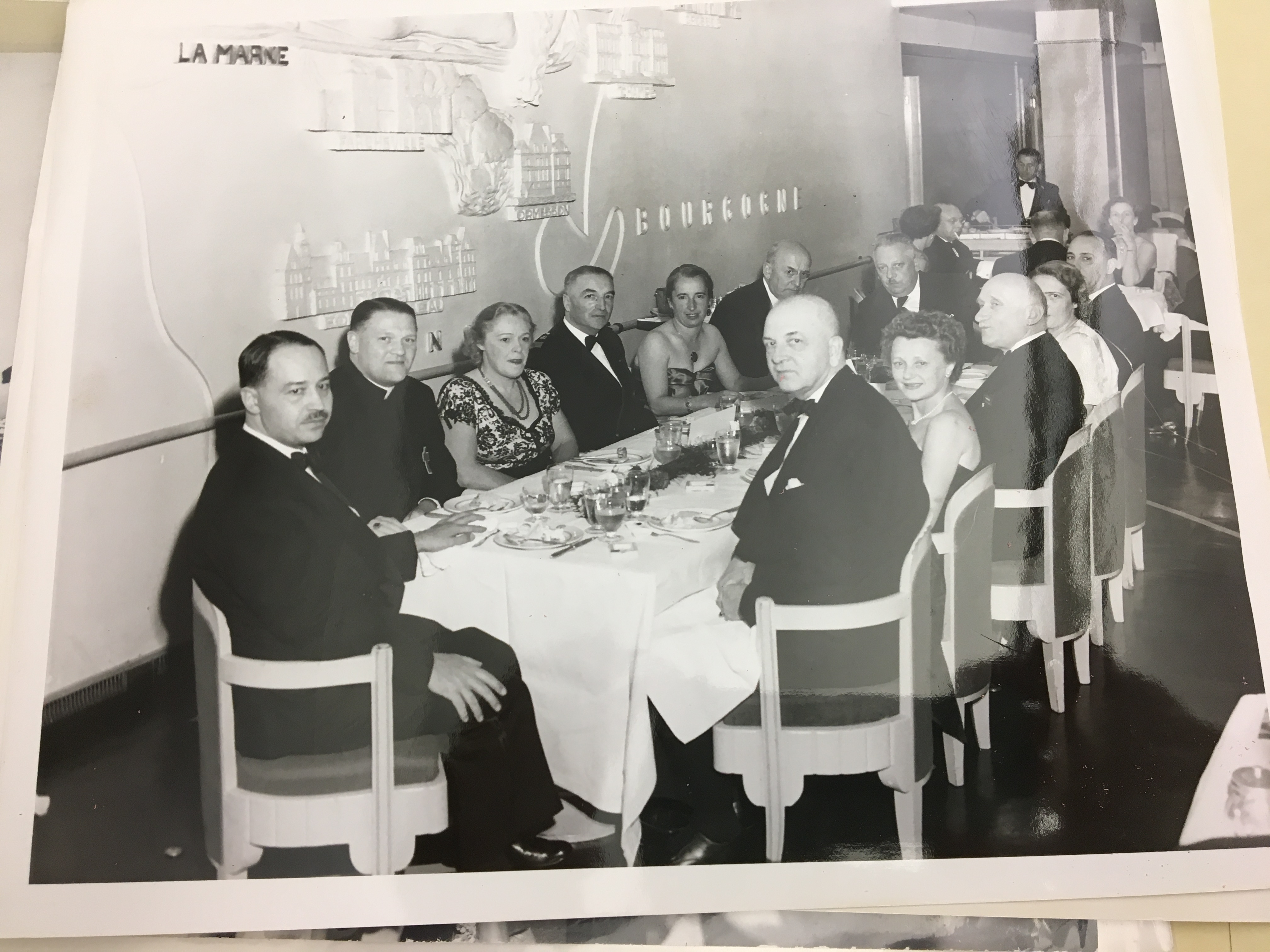 "photo of dinner party, Henrietta pictured on right. Dinner given by Captain of SS Il de France, 3rd from right (counterclockwise around table) Rob't Schuman, 10/2/50, ""Trip to Israel"" Px 88-1(596) A (dupl)"